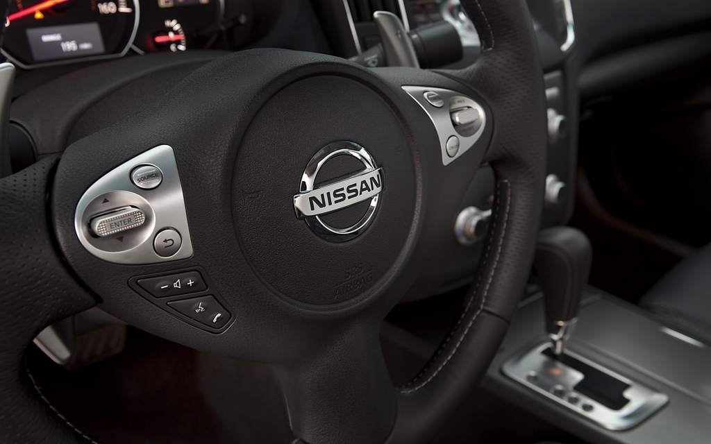 The steering wheel is covered in leather.