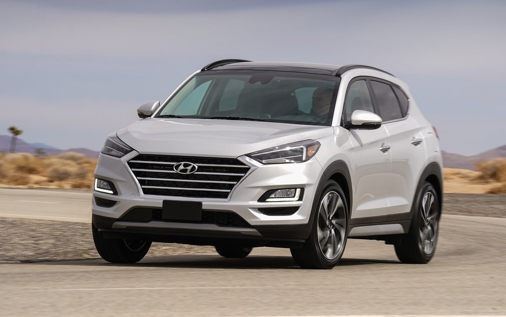vehicle top image red cuv hyundai silver of tucson exterior lining utility en crossover and tuscan showroom tinted img suv with windows