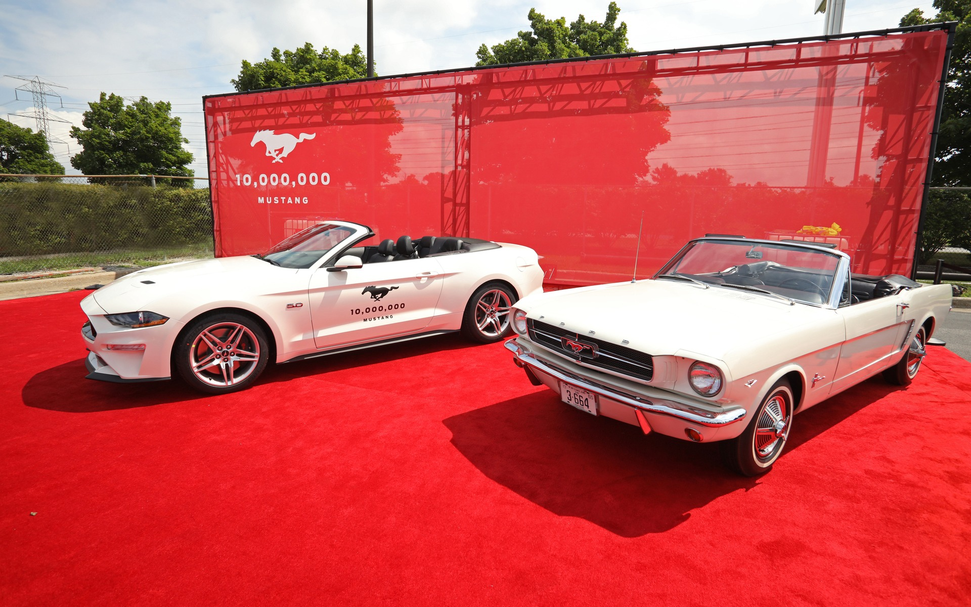 <p>The 10-millionth Ford Mustang next to the first-ever Mustang</p>
